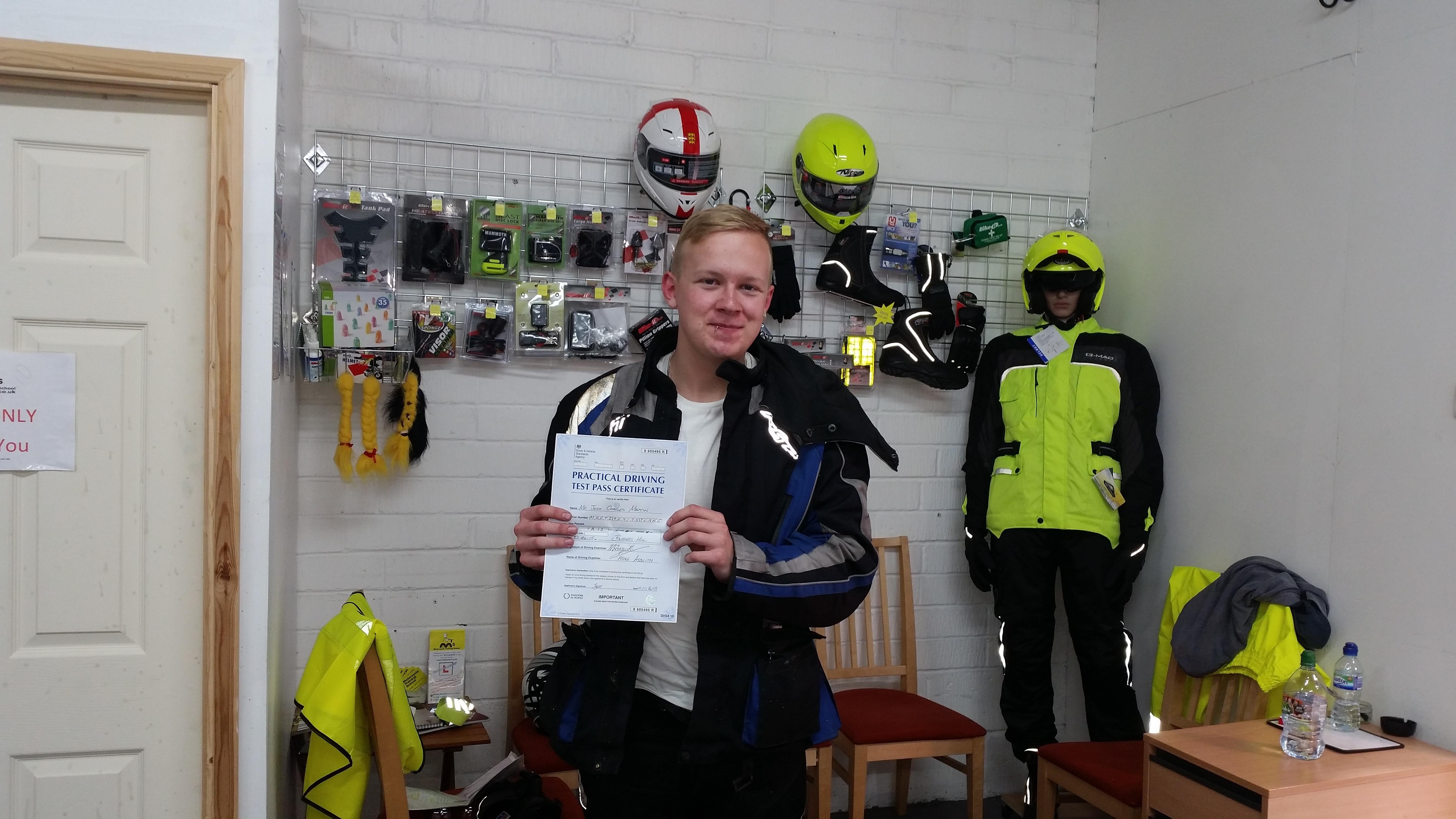 Jolly Josh Martin showing off his pass certificate.