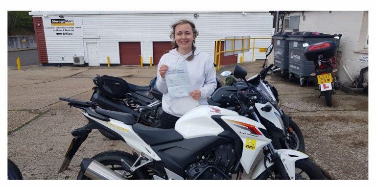 Lady biker passes A2